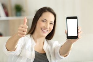 happy female showing a blank phone