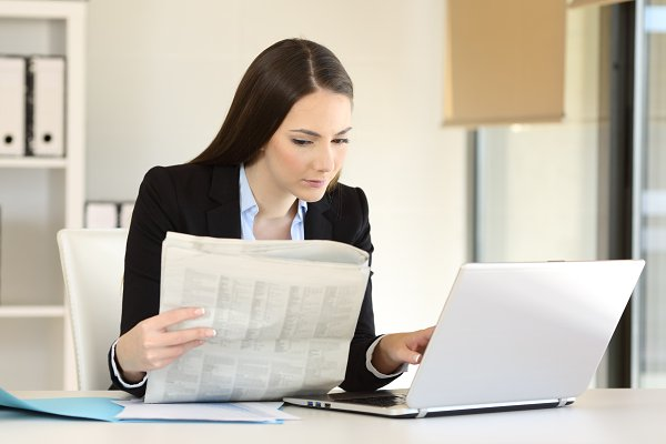 businesswoman working comparing a n…