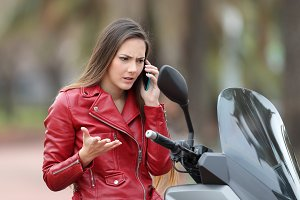 Angry motorbiker calling insurance