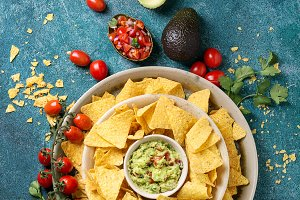 Mexican nachos served with guacamole
