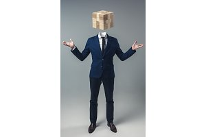 Businessman with Game Cube box instead of head