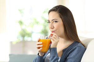 relaxed woman drinking orange juice