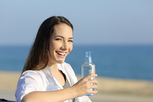 Happy woman holding a water bottle