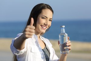 happy girl holding a water bottle