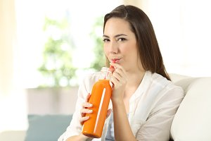 Girl drinking an orange juice