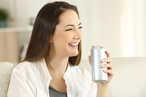 woman holding a soda can