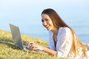 Happy woman using a laptop