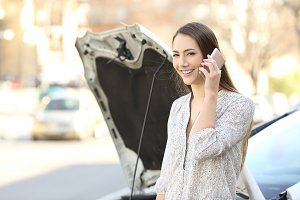 Happy driver calling insurance