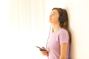 Relaxed teen listening to music