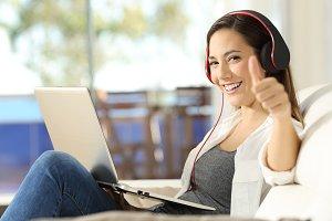 Satisfied woman wearing headphones