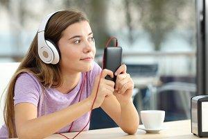 Single teen wearing headphones