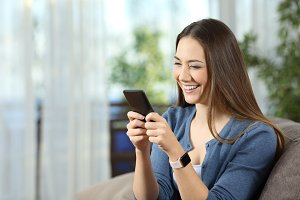 Happy woman wearing a smartwatch