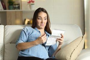 Distrustful pregnant lady reading