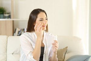 beauty woman moisturizing her face