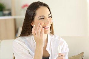 beauty woman applying moisturizer