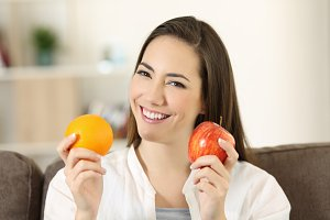 happy woman holding fruits