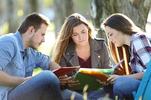 Group of three students studying