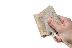Hands holding euro bills