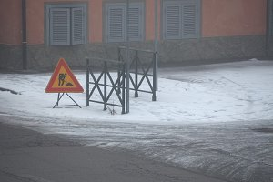 road works sign in the snow