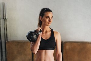 Young fitness woman standing in gym
