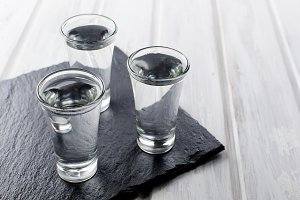 Vodka shots on black table
