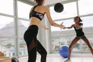 Women exercising with medicine ball