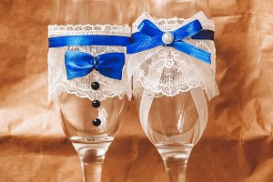 glasses for the newlyweds. wedding. decor. gold rings for wedding. stones in the ring