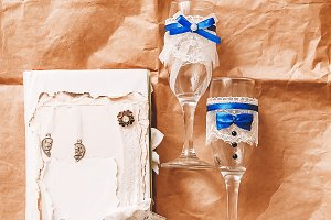 two glasses for the groom and the bride. album. wedding rings. white and yellow gold. wedding