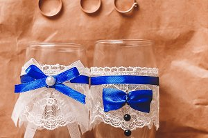 wedding glasses. wedding rings. gold for the wedding. celebration