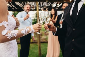 Wedding toast by newlywed couple