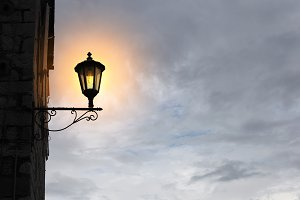 Old street light on sky background