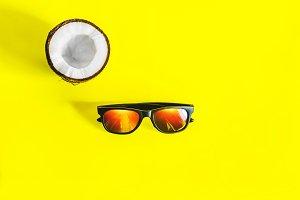 yellow background. Sunglasses for pr