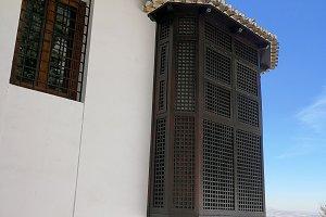 Balcony with lattice and blue sky