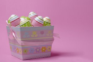 Colored Easter eggs in paper basket