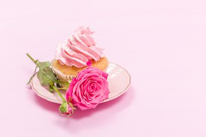 Cupcake with pink cream and rose