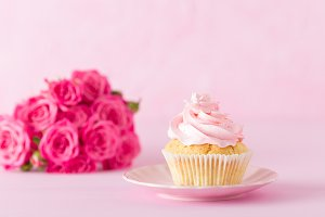 Cupcake with pink cream and roses