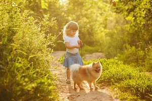 Little girl with dog standing