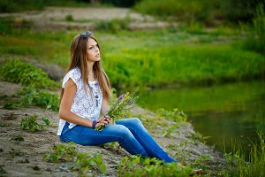 Teen Girl Boho barefoot on riverbank