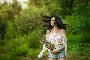Boho Girl holding wildflowers