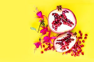 Pomegranate fruit with flowers