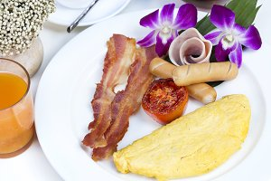 Close up American Breakfast with omelette,bacon and sausage.