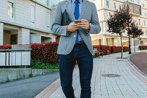 Businessman walking down the street