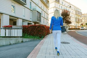 Businesswoman walking down the street