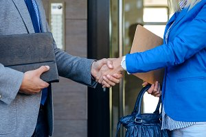 Businessman and businesswoman giving a handshake