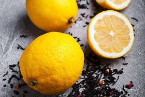 Lemon fruits and dry black tea