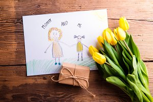Childs drawing of her mother, yellow tulips, little gift