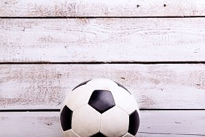 Soccer ball against wooden background. Studio shot. Copy space.