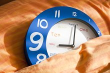 clock on bed sheets