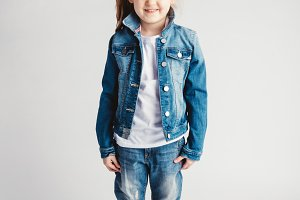 Girl in jeans clothes on white backg