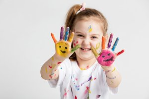 A girl showing her colorful painted